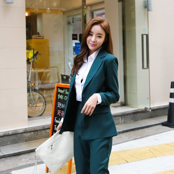 white shirt with buttons, dark green suit and light pink clutch