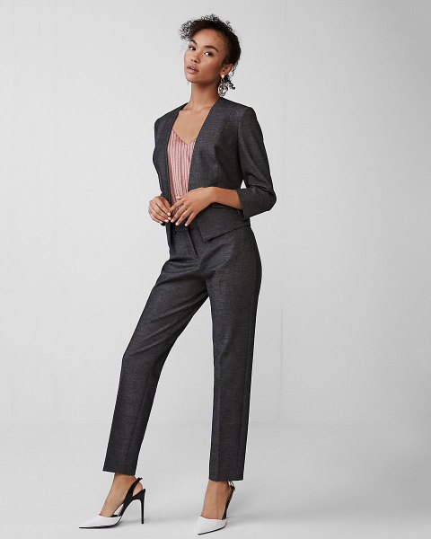 Slim fit suit with a striped top with a V-neck and white heels