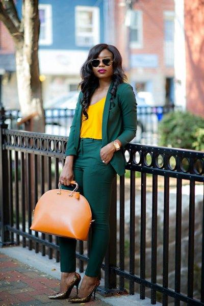 Lemon yellow tank top with dark suit and bronze heels