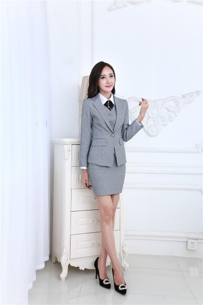 gray 3-piece skirt suite with white shirt and black tie