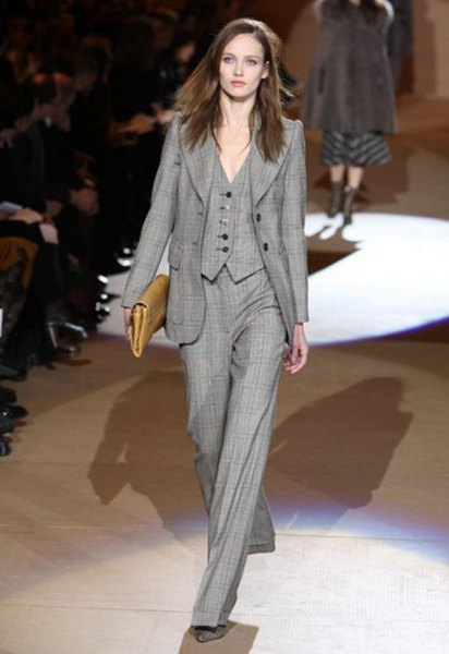 gray checked suit with wide-leg trousers and brown leather handbag