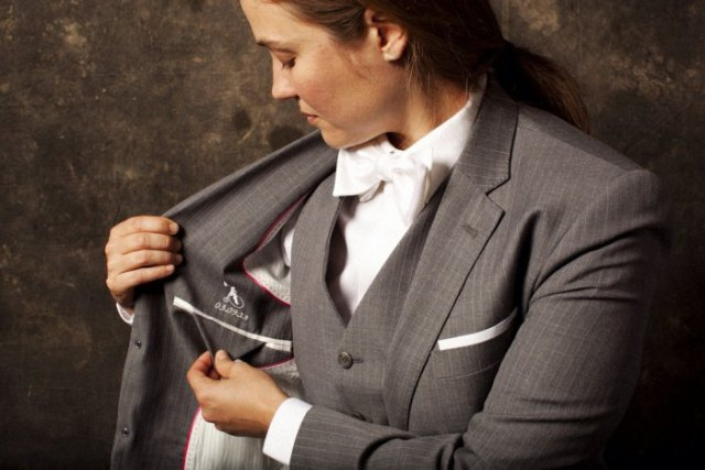 gray checked suit with matching vest and white bow tie