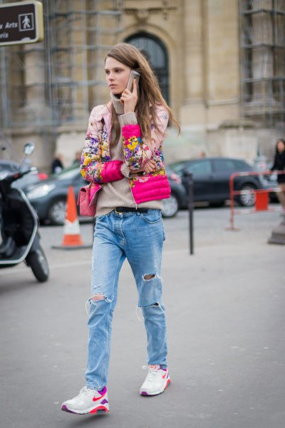blush pink floral bomber jacket with boyfriend jeans and white trail shoes