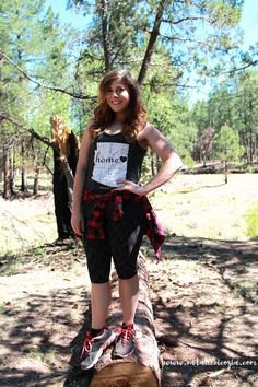 black graphic sleeveless top and knee high shorts
