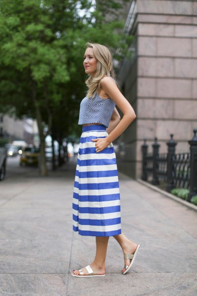 gray sleeveless top with blue and white, wide striped midi skirt