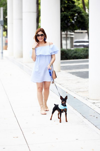 Light blue, strapless mini swing dress with bare flat strappy sandals