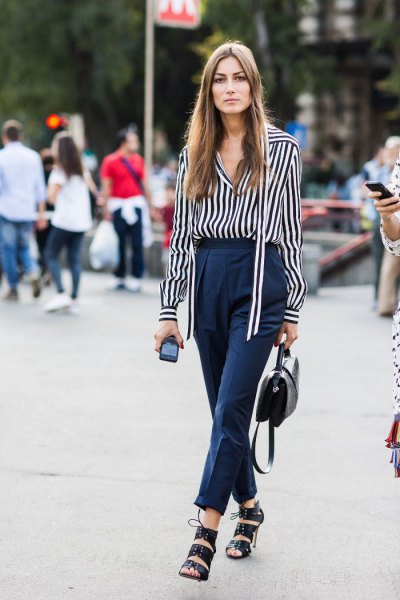 black and white striped long-sleeved shirt with dark blue chinos