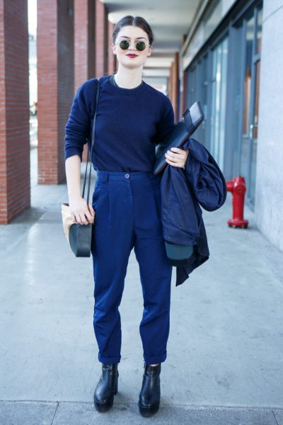 Dark blue sweater with matching trousers and leather boots