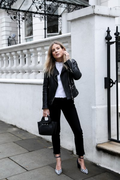 black moto jacket with skinny jeans and checkered heels
