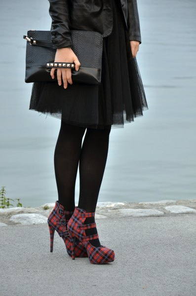 black leather jacket with mini tulle skirt and red checkered heels
