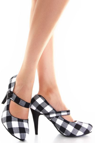 black and white checked ankle strap heels and flowing mini shorts