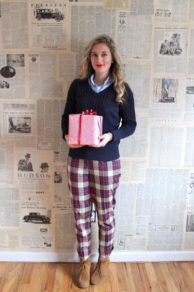 Dark blue sweater with gray and white checked pajama bottoms