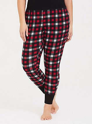black tank top with red and white checked pajama bottoms with a tapered leg
