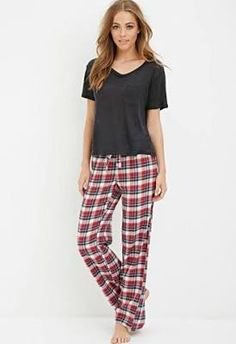 gray t-shirt with v-neck and checked trousers with a relaxed fit