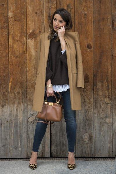 Camel longline wool coat with dark blue skinny jeans