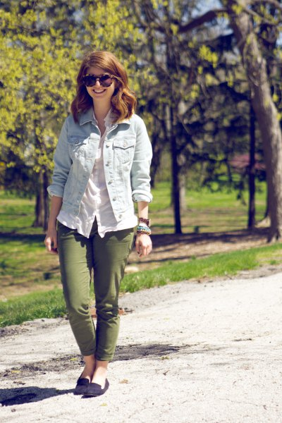 Light blue denim jacket with white linen blouse and green slim fit pants
