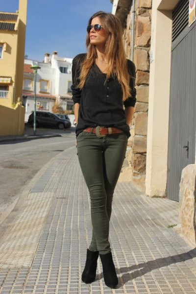 black long-sleeved T-shirt with green skinny trousers and ankle boots