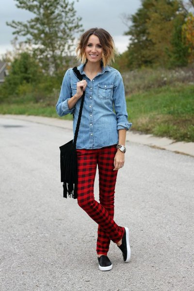 light blue chambray shirt with buttons and red and black checked pants