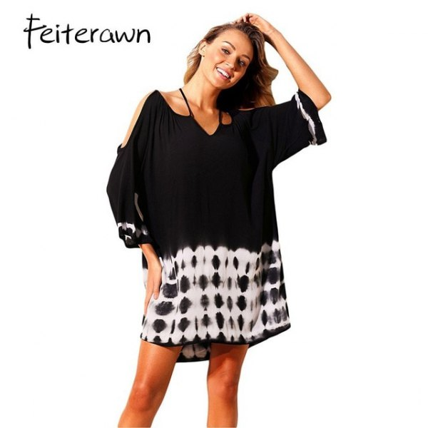 black blouse with cold sleeves and half sleeves over a batik dress