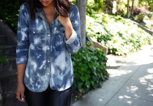 black and white washed denim shirt with buttons and leather leggings