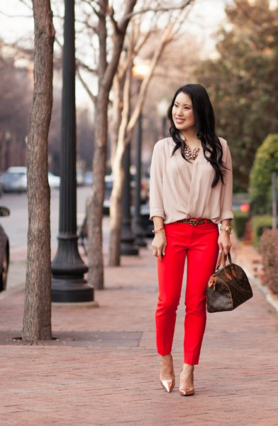 light pink blouse with red, cropped trousers and rose gold heels