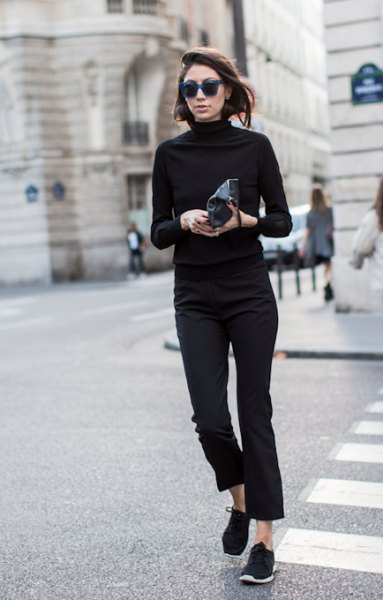 black mock neck sweater with shortened slim fit jeans and hiking shoes