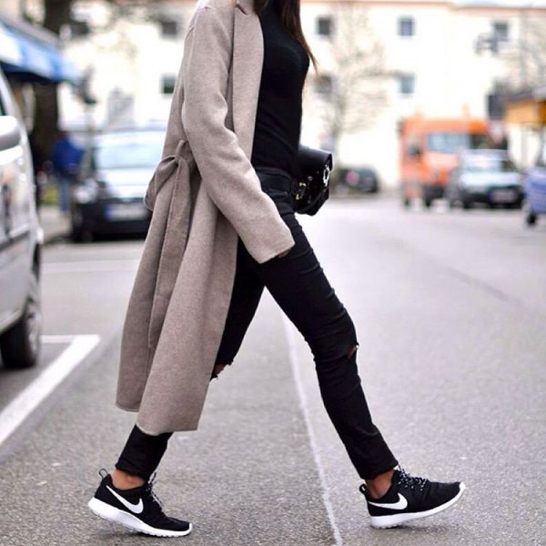 gray longline coat with black coated skinny jeans