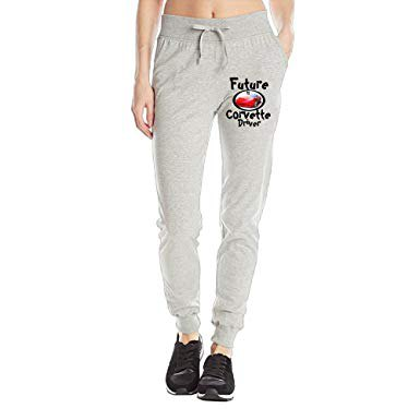 gray graphic fleece pants with black and white sneakers