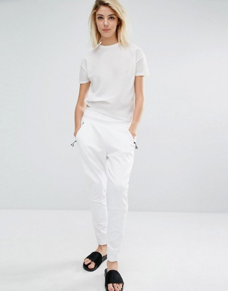 white t-shirt with matching trousers and black sandals
