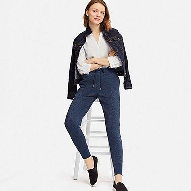 black leather jacket with dark blue fleece pants
