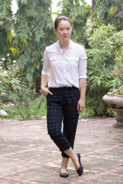 white printed blouse with dark green checked ankle pants