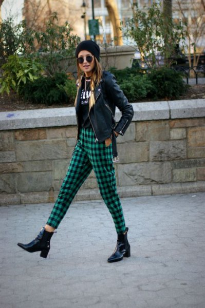 black moto jacket with knitted hat and green, checkered, short-cut trousers