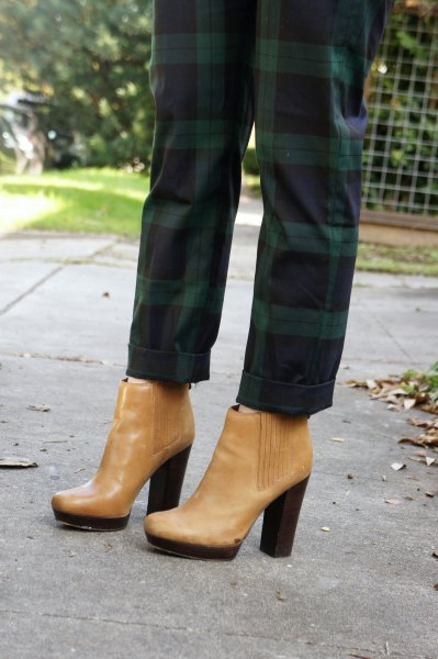 green checked pants with light brown leather boots with ankle heel