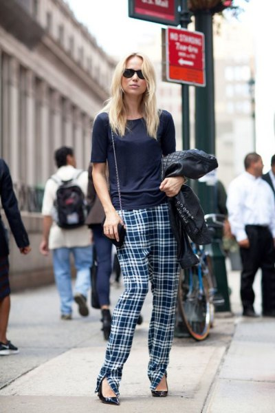 black t-shirt with checked trousers and pointed toe heels