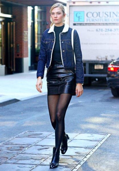 blue denim jacket with dark blue crew-neck sweater and black leather skirt