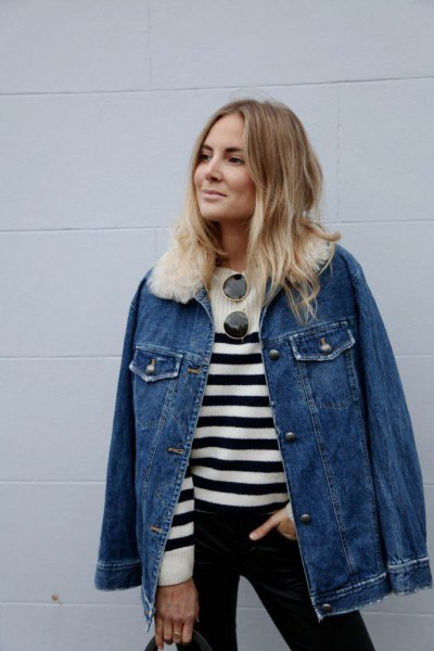 blue denim jacket with white faux fur collar and striped sweater