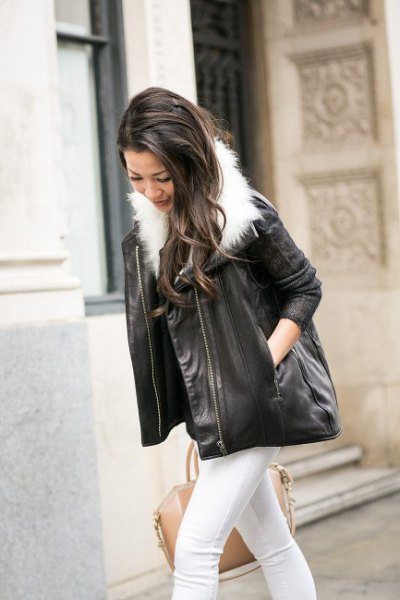 Skinny jeans and black leather jacket with white faux fur collar