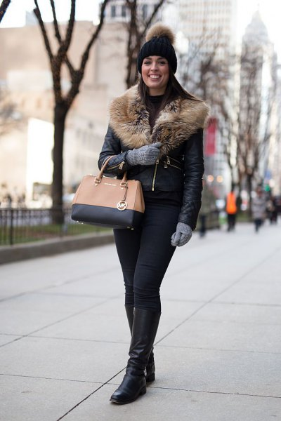 black leather jacket with fur collar, knitted hat and knee-high boots