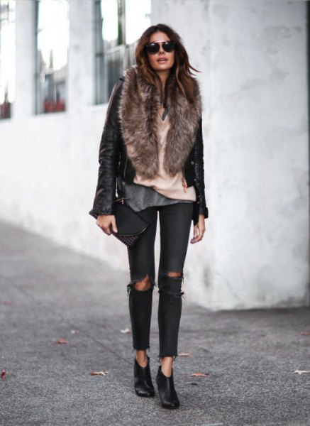 black leather moto jacket with faux fur collar and torn jeans