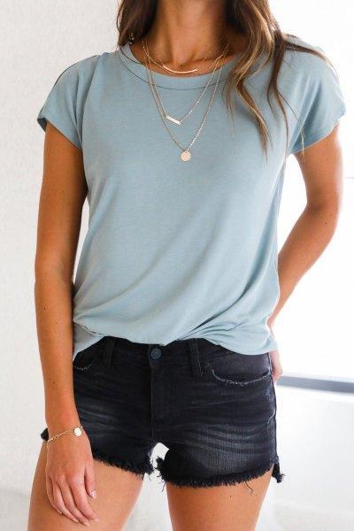 Light blue t-shirt with black washed mini shorts