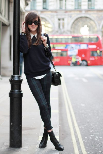 white shirt with buttons, black sweater and dark blue and gray checked tube pants