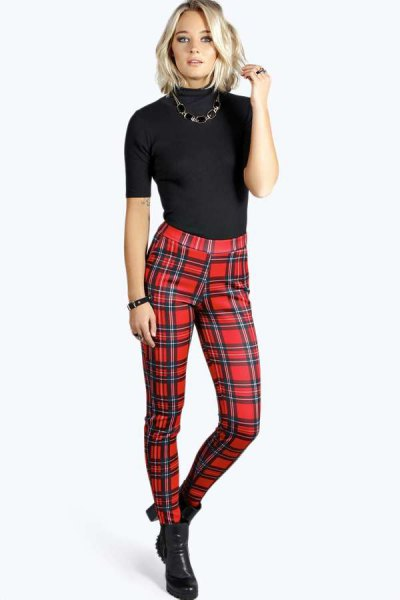 black short-sleeved sweater with mock-neck and red checked pants