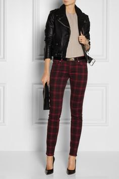 black moto jacket with gray blouse and checked pants