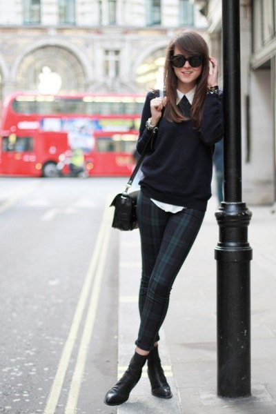 white shirt with button and black sweater with a slim fit