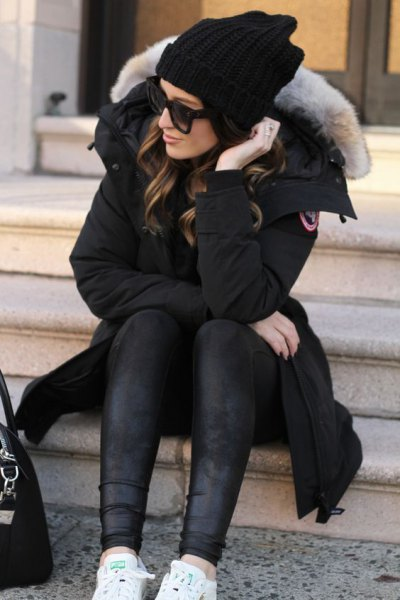 black longline parka jacket with fur collar and leather gaiters