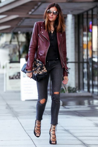 black leather jacket with dark blue, torn skinny jeans