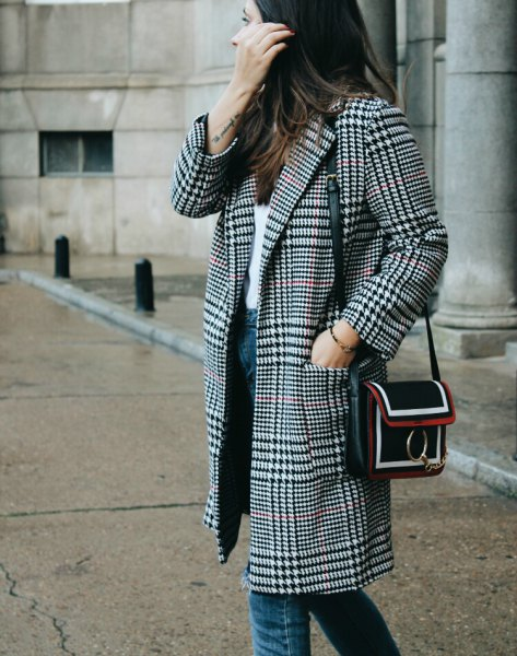 black and white checkered coat with white top and blue jeans