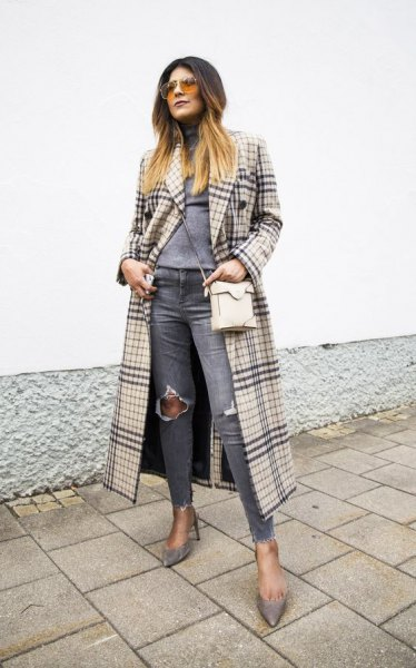 blushing pink and black maxi check coat with gray, torn jeans