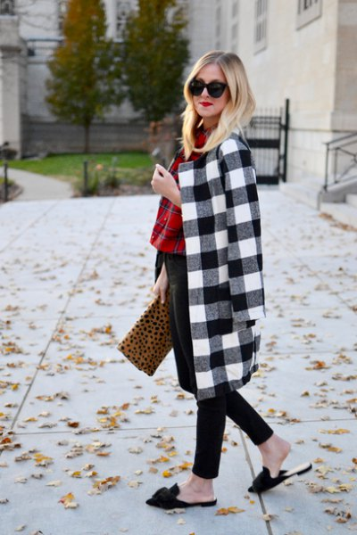 black and white checked longline wool coat with clutch bag with leopard print