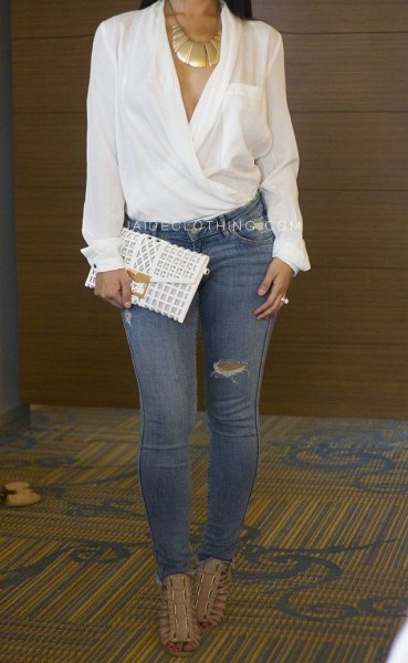 elegant white wrap blouse with blue torn skinny jeans